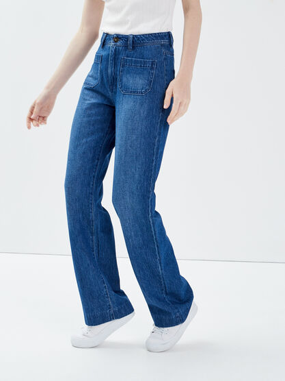 Jeans flare a poches plaquees denim stone femme