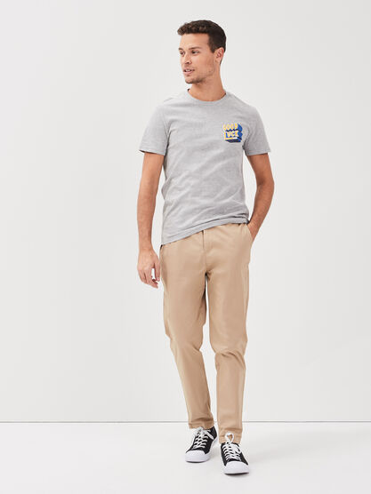 Pantalon chino a ourlets creme homme