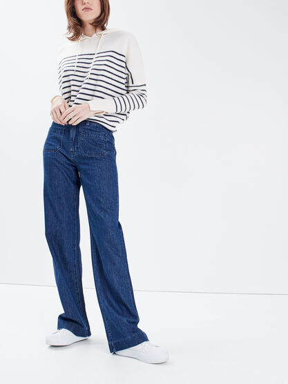 Jeans flare a poches plaquees denim brut femme